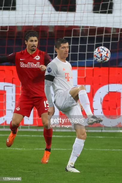 Andre Ramalho of Red Bull Salzburg and Robert Lewandowski of Bayern Muenchen battle for the ball during the UEFA Champions League Group A stage match...