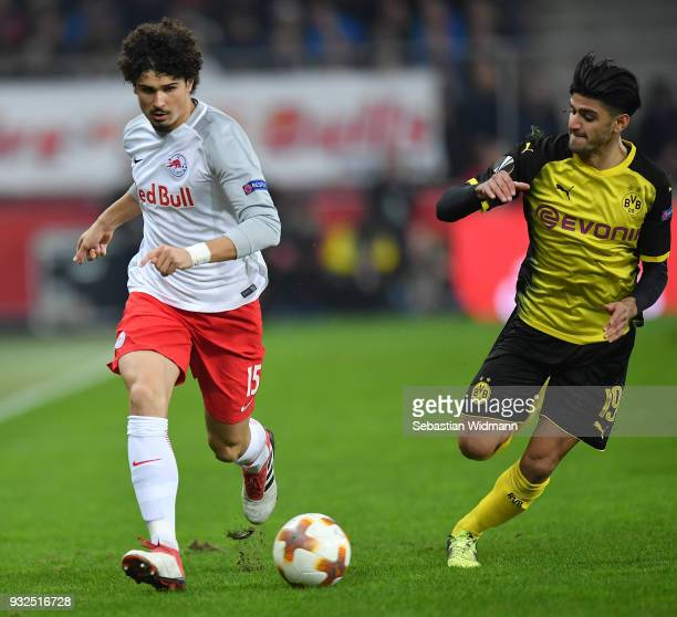 Andre Ramalho of Salzburg and Mahmoud Dahoud of Dortmund compete for the ball during the UEFA Europa League Round of 16 2nd leg match between FC Red...