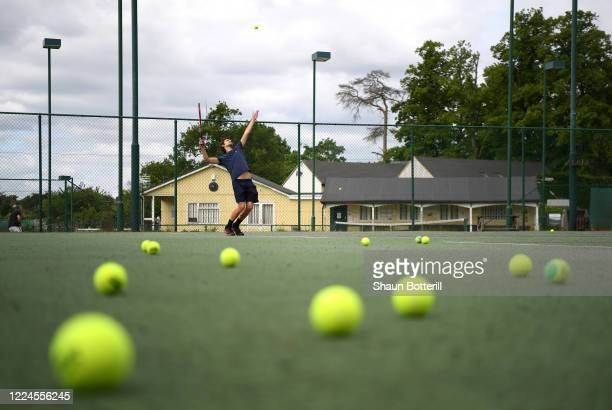 Andre Ramos serves the ball at Northampton County Lawn Tennis Club on May 13 2020 in Northampton United Kingdom The prime minister announced the...