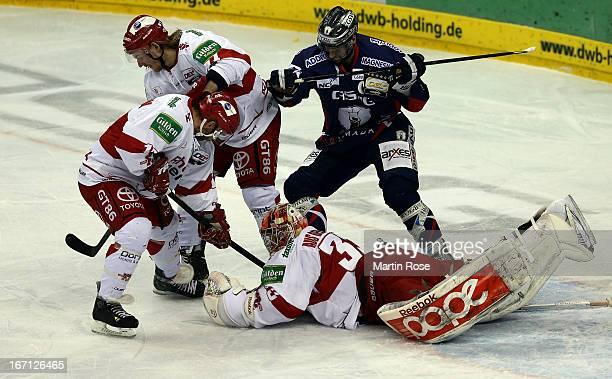Andre Rankel of Berlin fails to ober Danny aus den Birken , goaltender of Koeln in game four of the DEL final play-offs between Eisbaeren Berlin and...