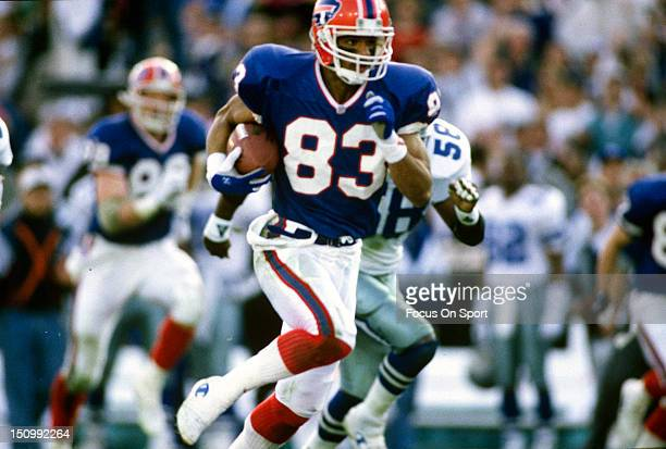 Andre Reed of the Buffalo Bills runs with the ball after a catch against the Dallas Cowboys during Super Bowl XXVII at the Georgia Dome January 30...