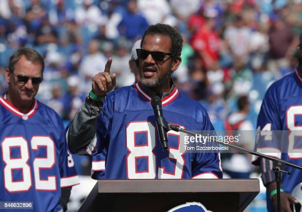 Andre Reed of the Buffalo Bills speaks to fans at a halftime ceremony honoring the 25th anniversary of the greatest comeback win in NFL history...