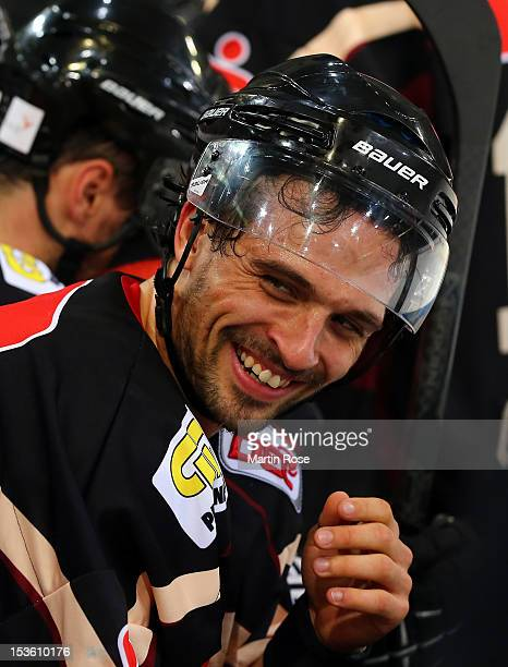 Andre Reiss of Hannover looks happy during the DEL match between Hannover Scorpions and Augsburger Panther at TUI Arena on October 7, 2012 in...