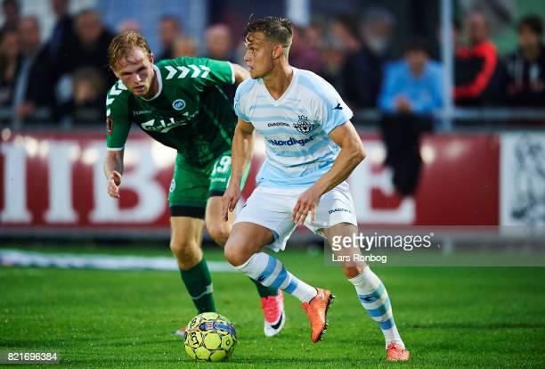 Andre Riel of FC Helsingor and Mikkel Desler of OB Odense compete for the ball during the Danish Alka Superliga match between FC Helsingor and OB...