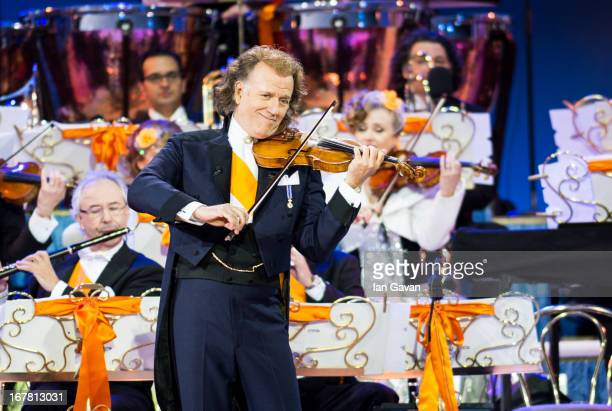 Andre Rieu performs on stage at Museumplien during the inauguration of King Willem Alexander of the Netherlands as Queen Beatrix of the Netherlands...