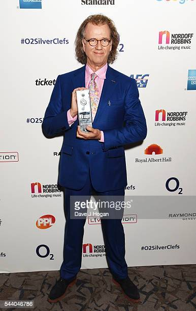 Andre Rieu poses with the PPL Classical Award during the Nordoff Robbins O2 Silver Clef Awards on July 1 2016 in London United Kingdom