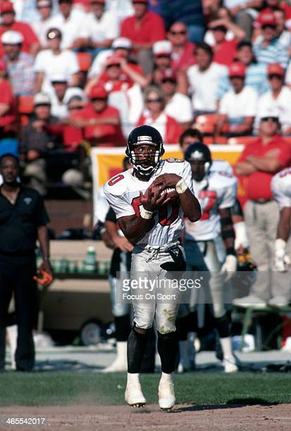 Andre Rison of the Atlanta Falcons catches a pass against the San Francisco 49ers during an NFL Football game September 23 1990 at Candlestick Park...