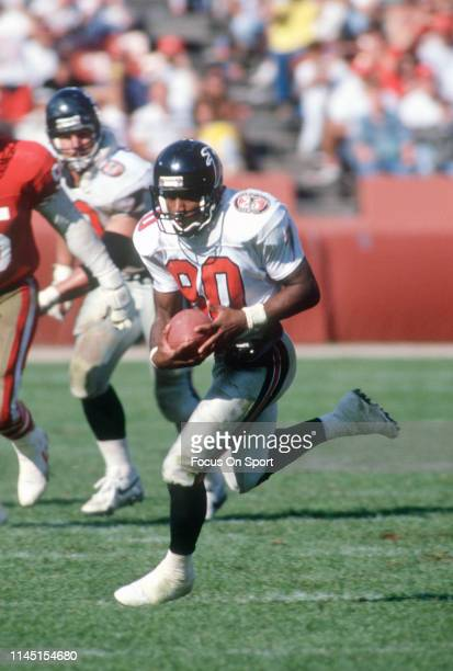 Andre Rison of the Atlanta Falcons runs with the ball after a catch against the San Francisco 49ers during an NFL Football game September 23 1990 at...