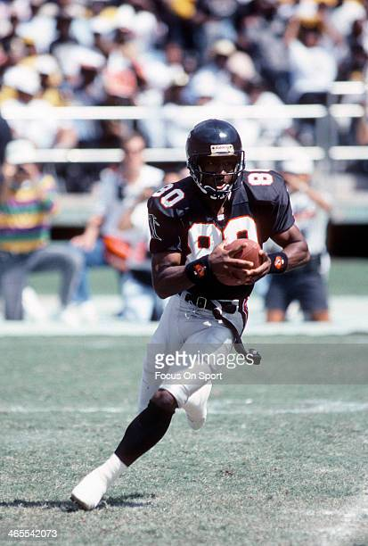 Andre Rison of the Atlanta Falcons runs with the ball against the New Orleans Saints during an NFL Football game September 29 1991 at AtlantaFulton...