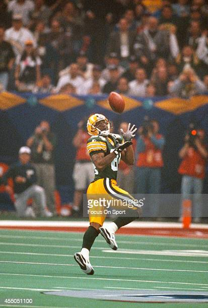 Andre Rison of the Green Bay Packers catches a pass against the New England Patriots during Super Bowl XXXI January 26 1997 at the Louisiana...