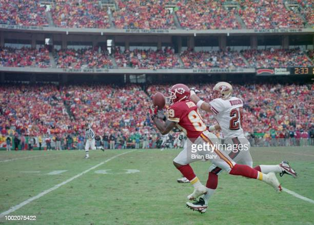 Andre Rison Wide Receiver for the Kansas City Chiefs catches the pass as Rod Woodson Defensive back for the San Francisco 49ers tries to intercept...