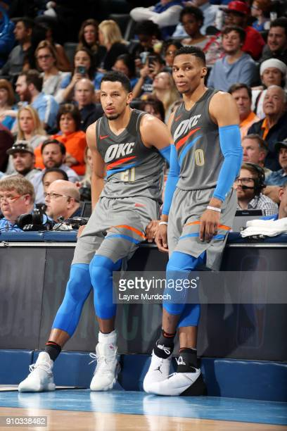 Andre Roberson and Russell Westbrook of the Oklahoma City Thunder look on during the game against the Washington Wizards on January 25 2018 at...