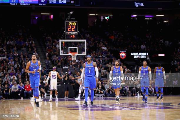 Andre Roberson Carmelo Anthony Steven Adams Russell Westbrook and Paul George of the Oklahoma City Thunder walk back to the bench during their loss...