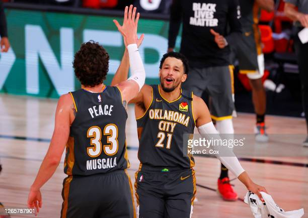 Andre Roberson celebrates with Mike Muscala of the Oklahoma City Thunder after Muscala hit a three point basket against the Miami Heat during the...