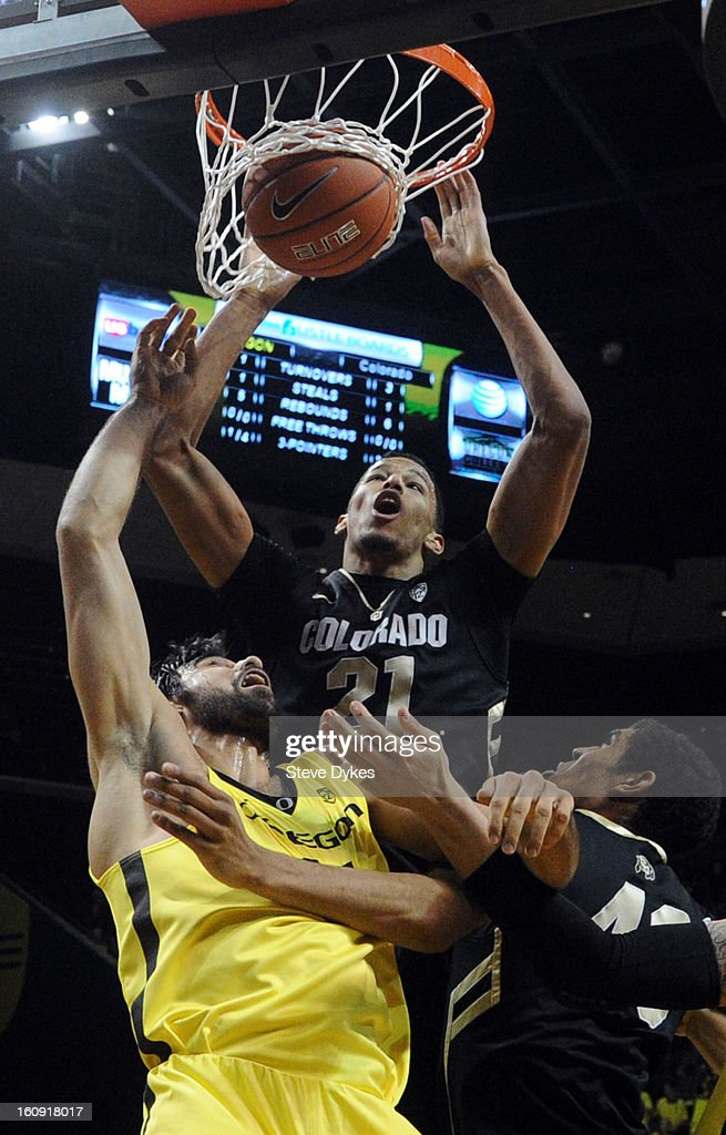 Andre Roberson #21 of the Colorado Buffaloes dunks the ball on Arsalan Kazemi #14 of the Oregon Ducks in the first half of the game at Matthew Knight Arena on February 7, 2013 in Eugene, Oregon.