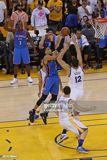 Andre Roberson of the Oklahoma City Thunder drives to the basket against the Golden State Warriors in Game Five of the Western Conference Finals...