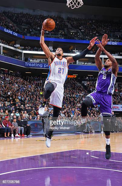 Andre Roberson of the Oklahoma City Thunder dunks against Rudy Gay of the Sacramento Kings on November 23 2016 at Golden 1 Center in Sacramento...