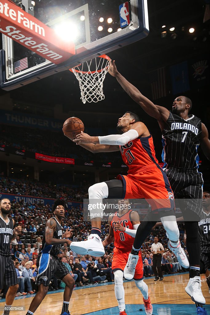 Andre Roberson #21 of the Oklahoma City Thunder goes up for a shot against Serge Ibaka #7 of the Orlando Magic during a game on November 13, 2016 at Chesapeake Energy Arena in Oklahoma City, Oklahoma.