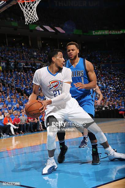 Andre Roberson of the Oklahoma City Thunder handles the ball against Justin Anderson of the Dallas Mavericks in Game Five of the Western Conference...