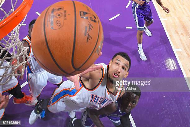 Andre Roberson of the Oklahoma City Thunder rebounds against Darren Collison of the Sacramento Kings on November 23 2016 at Golden 1 Center in...