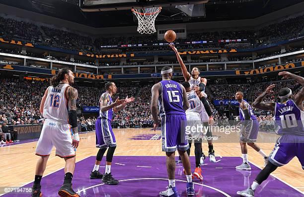 Andre Roberson of the Oklahoma City Thunder rebounds against the Sacramento Kings on November 23 2016 at Golden 1 Center in Sacramento California...