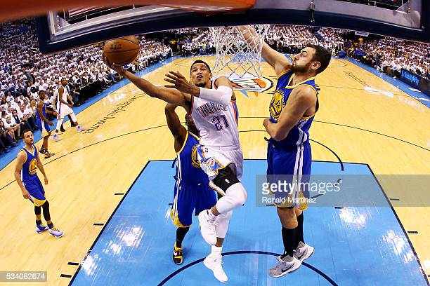 Andre Roberson of the Oklahoma City Thunder shoots against Andrew Bogut of the Golden State Warriors in the first half in game four of the Western...