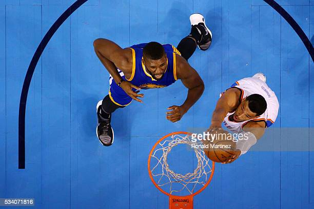 Andre Roberson of the Oklahoma City Thunder shoots against Festus Ezeli of the Golden State Warriors in the first half in game four of the Western...
