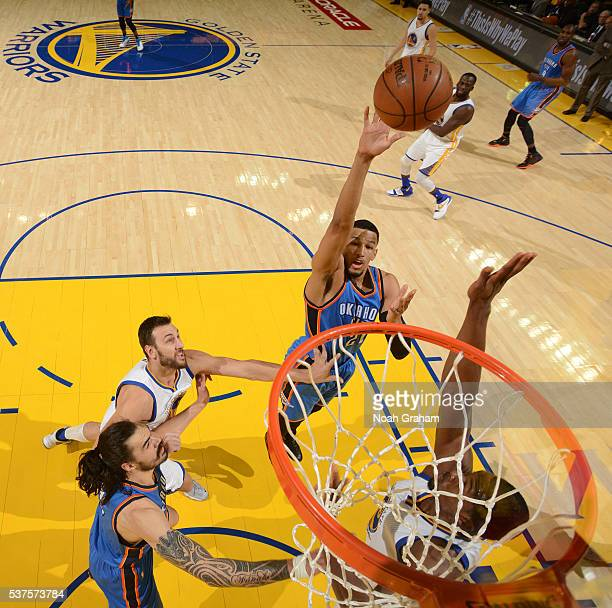 Andre Roberson of the Oklahoma City Thunder shoots the ball against the Golden State Warriors in Game Five of the Western Conference Finals during...