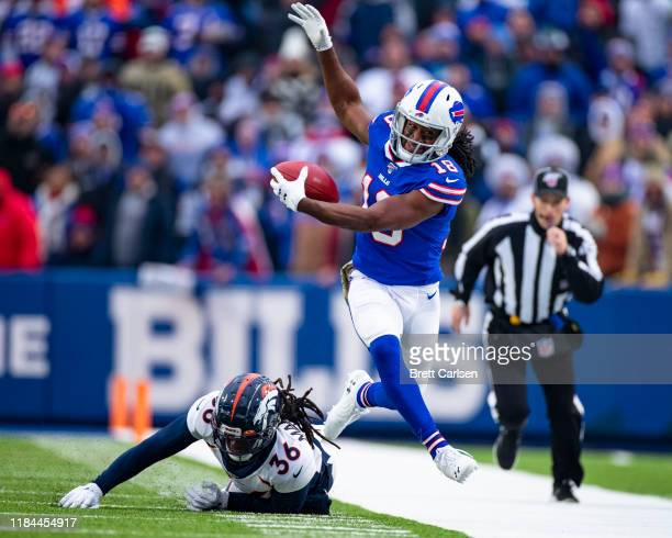Andre Roberts of the Buffalo Bills hurdles as he is forced out of bounds after making contact with Trey Marshall of the Denver Broncos during the...