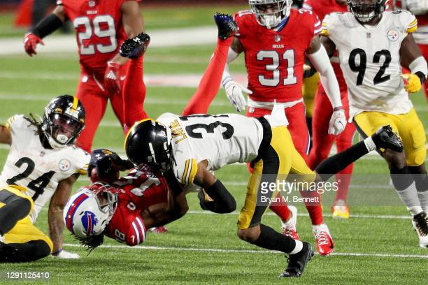 Andre Roberts of the Buffalo Bills is tackled by Justin Layne of the Pittsburgh Steelers on a punt return during the third quarter in the game at...