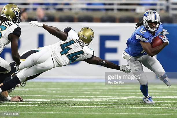 Andre Roberts of the Detroit Lions runs back a punt return for a touchdownpast Myles Jack of the Jacksonville Jaguars during first half action...