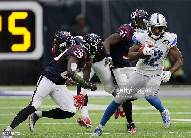 Andre Roberts of the Detroit Lions rushes past Alfred Blue of the Houston Texans, Andre Hal and Charles James at NRG Stadium on October 30, 2016 in...