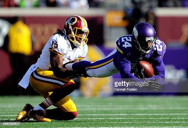Andre Roberts of the Washington Redskins tackles Captain Munnerlyn of the Minnesota Vikings after Munnerlyn intercepted a pass during the second...