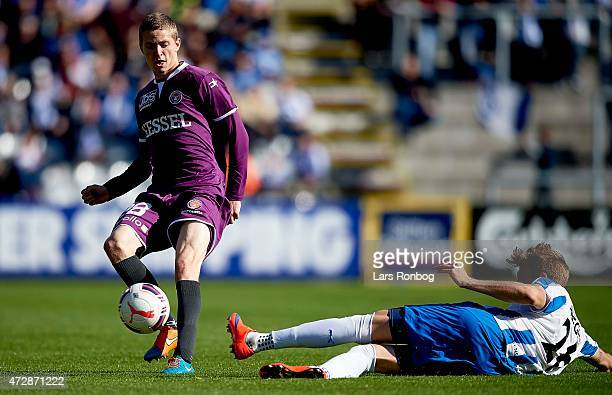 Andre Romer of FC Midtjylland and Daniel Hoegh of OB Odense compete for the ball during the Danish Alka Superliga match between OB Odense and FC...
