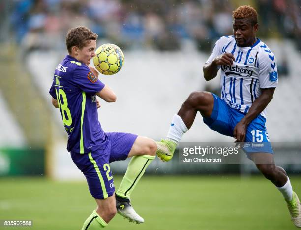 Andre Romer of FC Midtjylland and Izunna Uzochukwu of OB Odense compete for the ball during the Danish Alka Superliga match between OB Odense and FC...