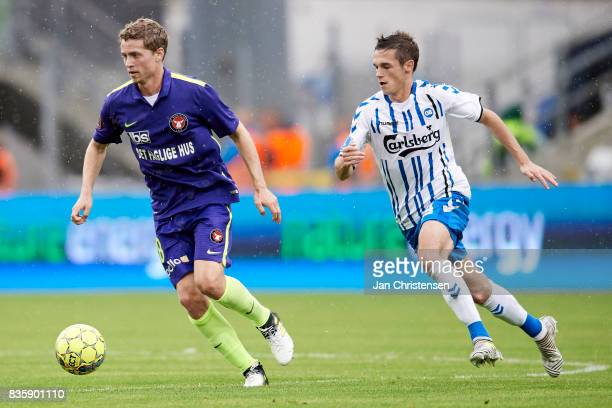 Andre Romer of FC Midtjylland and Jens Jakob Thomasen of OB Odense in action during the Danish Alka Superliga match between OB Odense and FC...