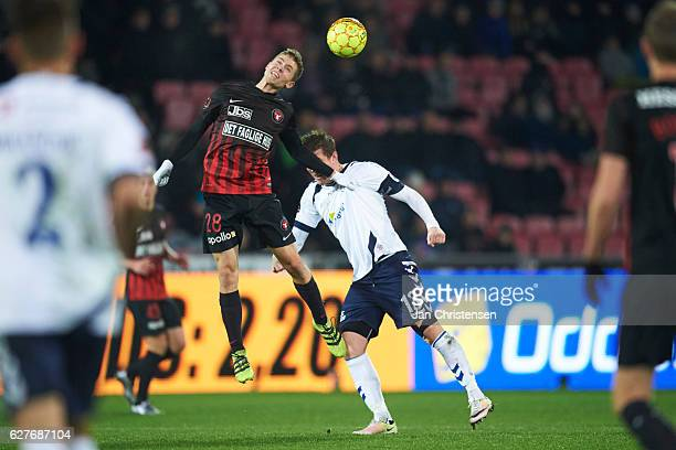 Andre Romer of FC Midtjylland and Morten Duncan Rasmussen of AGF Arhus compete for the ball during the Danish Alka Superliga match between FC...