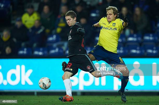 Andre Romer of FC Midtjylland and Teemu Pukki of Brondby IF compete for the ball during the Danish Alka Superliga match between Brondby IF and FC...