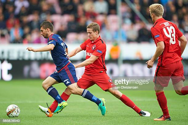 Andre Romer of FC Midtjylland compete for the ball during the UEFA Europa League match between FC Midtjylland and Videoton FC at MCH Arena on August...