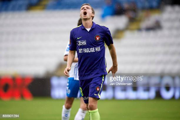 Andre Romer of FC Midtjylland looks dejected after a missed goal during the Danish Alka Superliga match between OB Odense and FC Midtjylland at...