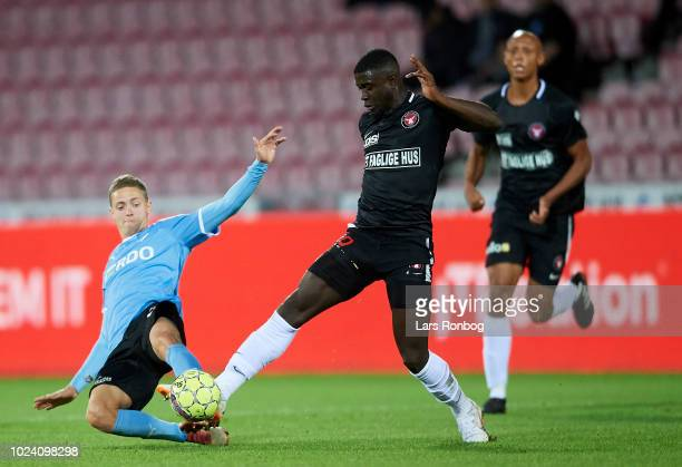 Andre Romer of Randers FC and Mayron George of FC Midtjylland compete for the ball during the Danish Superliga match between FC Midtjylland and...