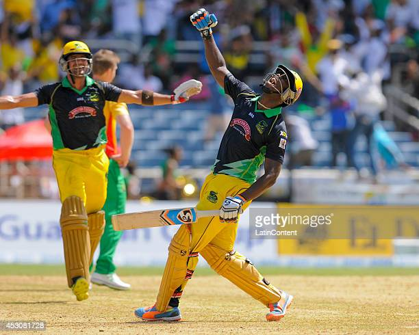 Andre Russell of Jamaica Tallawahs celebrates after hitting the winning runs during a match between Jamaica Tallawahs and Guyana Amazon Warriors as...