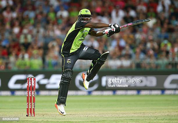 Andre Russell of the Thunder bats during the Big Bash League match between the Sydney Thunder and Brisbane Heat at Spotless Stadium on December 28...