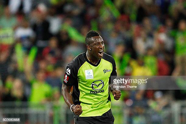Andre Russell of the Thunder celebrates after claiming the wicket of Brad Hodge of the Strikers during the Big Bash League match between the Sydney...