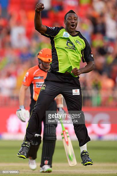 Andre Russell of the Thunder celebrates after taking the wicket of Michael Klinger of the Scorchers during the Big Bash League match between the...