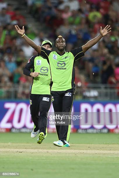 Andre Russell of the Thunder celebrates taking the wicket of Daniel Hughes of the Sixers during the Big Bash League match between the Sydney Thunder...