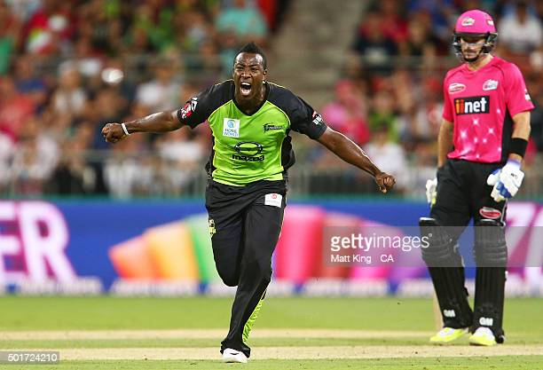 Andre Russell of the Thunder celebrates taking the wicket of Nic Maddinson of the Sixers during the Big Bash League match between the Sydney Thunder...