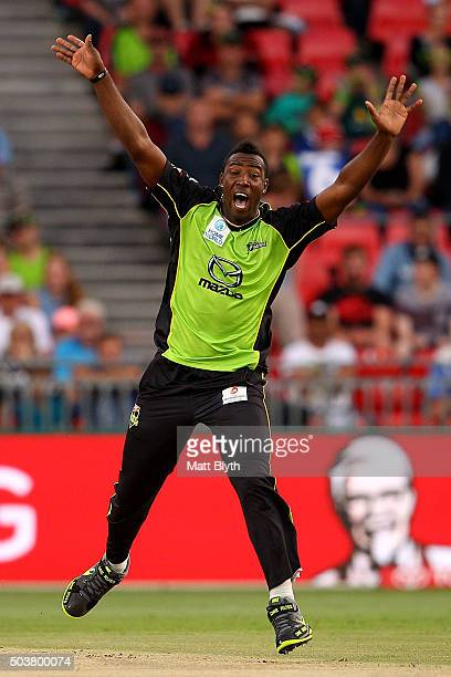 Andre Russell of the Thunder celebrates the wicket of Michael Klinger of the Scorchers during the Big Bash League match between the Sydney Thunder...
