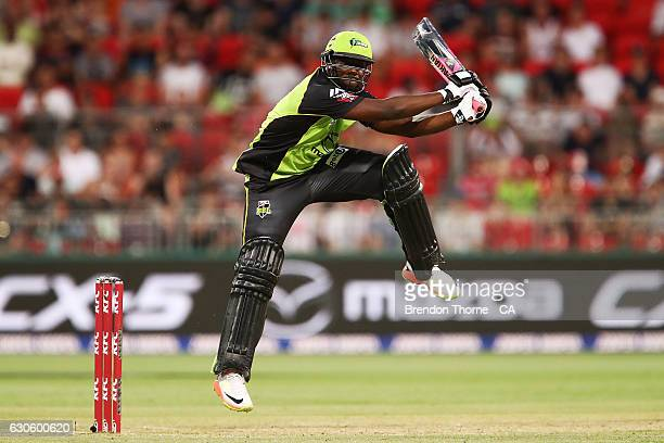 Andre Russell of the Thunder hits for six during the Big Bash League match between the Sydney Thunder and Brisbane Heat at Spotless Stadium on...