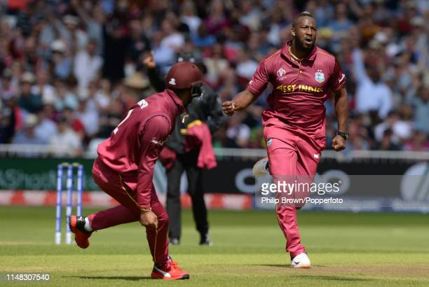Andre Russell of the West Indies celebrates after dismissing Usman Khawaja of Australia in the pavilion before the ICC Cricket World Cup Group Match...